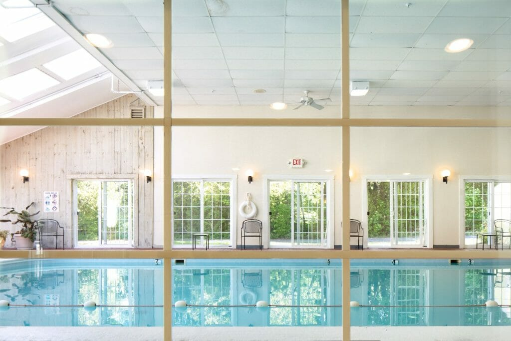 viewing the indoor pool through a window at Country Inn - hotel in camden maine